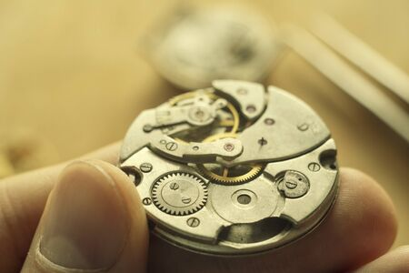 Watchmaker is repairing the wristwatch, mechanical watch