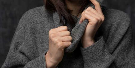 Nice girl weared in the sweater