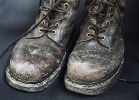 Old dirty brown shoes, close up, boots need to be cleaned