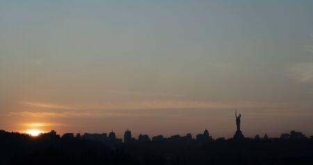 Silhouette of the right bank of the city of Kiev, sunset