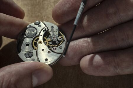 Mechanical watch repair, watchmakers workshop, close up
