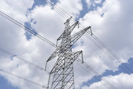 High voltage transmission lines, close up, clouds
