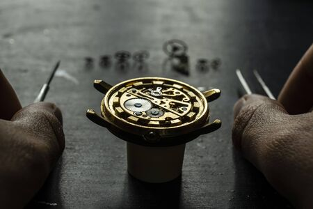 Mechanical watch repair. Watchmaker is repairing