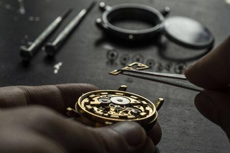 Mechanical watch repair. Watchmaker is repairing