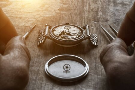 Watchmaker is repearing machanical watches