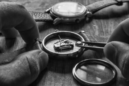 Replacing the watch battery, watchmaker's workshop, close up