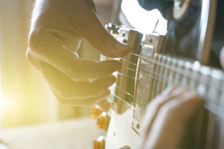 Man play the guitar at home Zdjęcie Seryjne