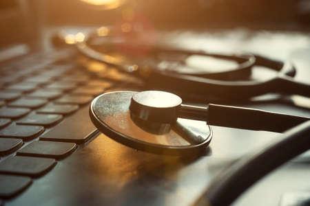 Stethoscope on laptop, computer repair