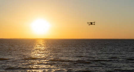 Quadcopter in the sky over the sea