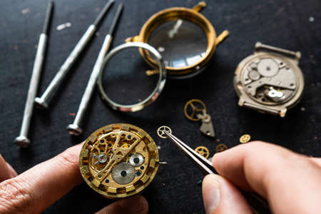 Watchmaker is repearing mechanical wrist watch