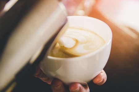 Hand on Barista making latte cafe