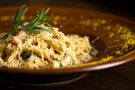 Delicious italian pasta on wooden background