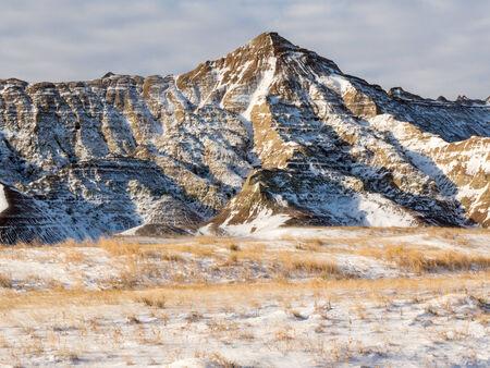 rugged terrain: Rugged winter terrain in the Badlands National Park of South Dakota.