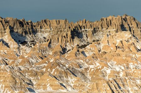 Rugged winter terrain in the Badlands National Park of South Dakota.