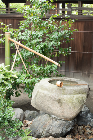 Water Spout and Stone at Bhuddist Temple in Kyoto, Japan