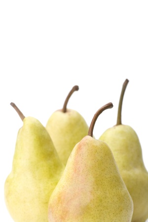 Four yellow pears on a white background, close-up. photo