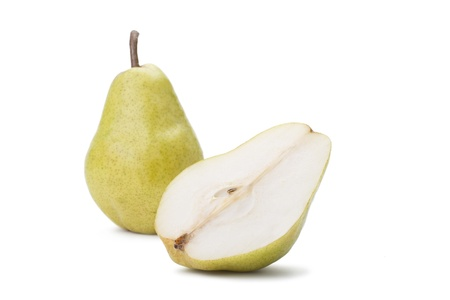 Whole and half a pear on a white background.
