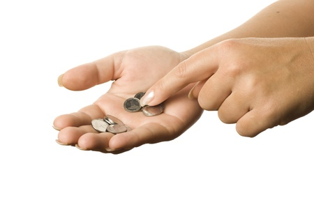 Coins on the palm on a white background. photo