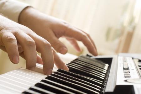 Fingers relate piano keys. Stock Photo - 9352088