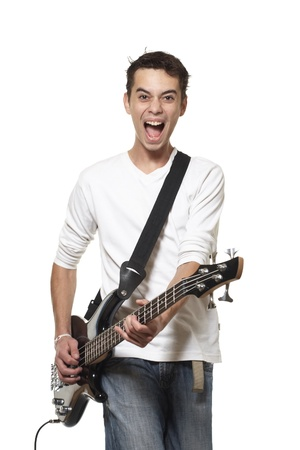 The young guy with a bass guitar on a white background.