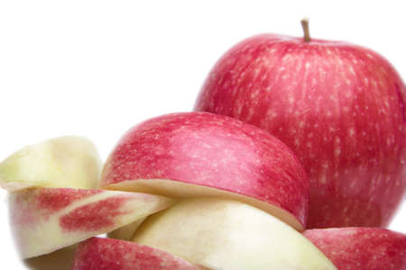Red apple and sliced on white background. photo