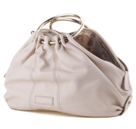 Stylish womens handbag on a white background.