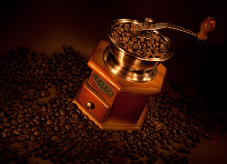 Coffee grinder with coffee beans.