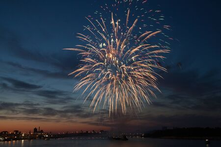 Colorful fireworks in the night sky with reflection on water. Stock Photo