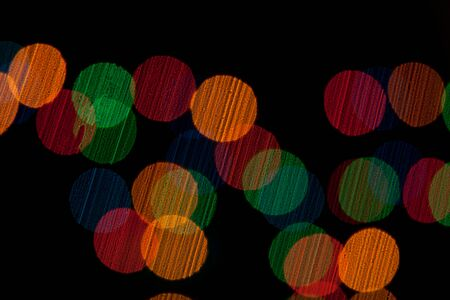 Color Bokeh against a dark background. Stock Photo - 11240337