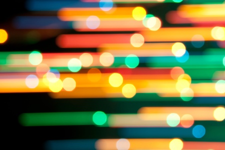 holiday lighting: Color Bokeh on a dark background.  Line. Stock Photo