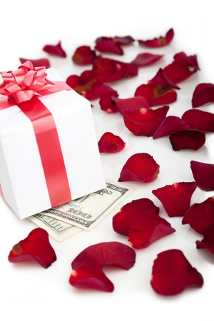 Gift box, rose petals on white background. photo