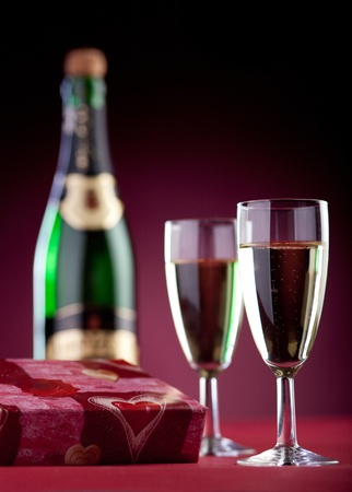 gift box, two glasses and a bottle of champagne. photo