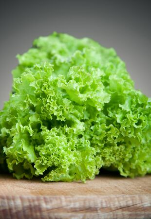 Fresh lettuce leaves on cutting board. Stock Photo