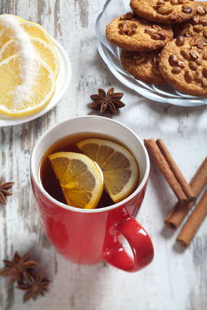 cup of tea with lemon wedges