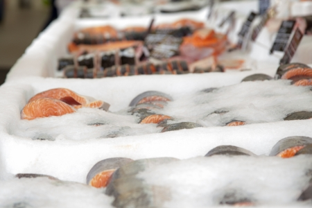 Salmon steak in the ice on the counter in the store