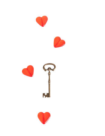 Red heart with a metal key on white  Isolation  Stock Photo