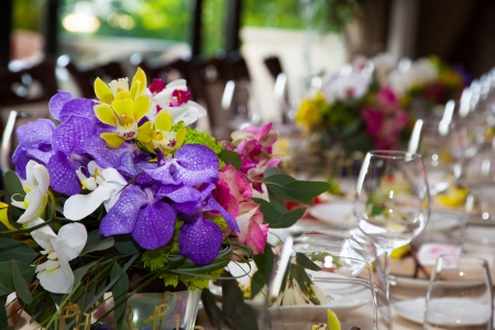 A bouquet of flowers on the decorated table in the restaurant  photo