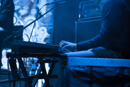 Artist plays on a synthesizer for the concert
