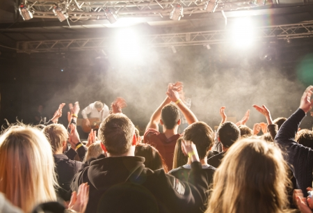 concert crowd: The audience applauded by the stage artist  They shines the spotlight  Stock Photo