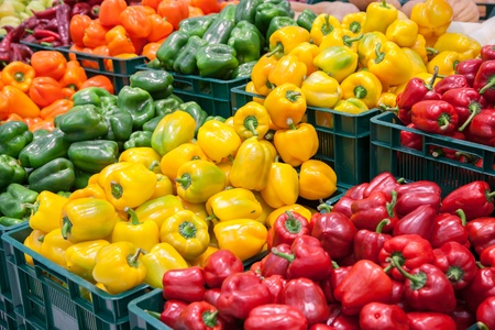Boxes with colorful peppers on the market  Stock Photo