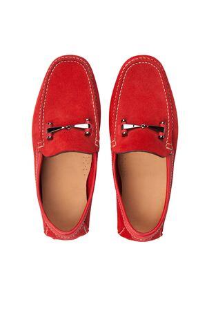 clasp feet: Stylish, summer mens leather shoes on white. Isolated. Stock Photo