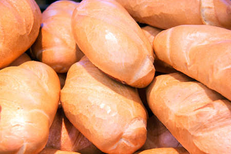 Freshly baked bread closeup, folded on a shelf in a store. Stock Photo