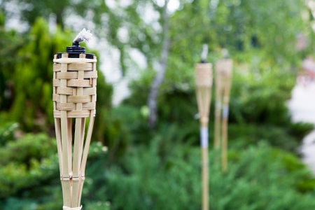 torches: Decoration tiki oil torches for lighting or insect repellent. Stock Photo
