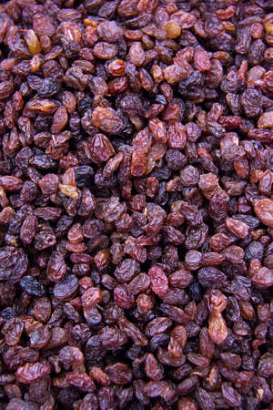 Black raisins close up. Filled the whole frame. Stock Photo