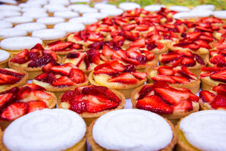 Tasting table with different choux pastry with cream and fruit. Stock Photo