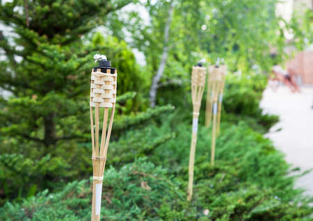 capacitance: Decoration tiki oil torches for lighting or insect repellent. Stock Photo