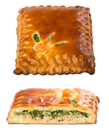 Homemade pie with salmon and spinach on a white background.