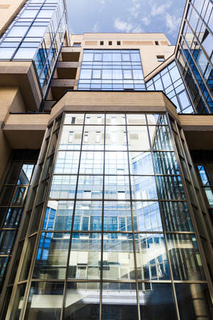Office building close up with large glass windows.  Stock Photo
