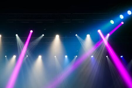 lighting equipment: Stage lights on concert. Lighting equipment with multi-colored beams.
