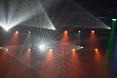 unrecognizable: Stage lights on concert. Lighting equipment with multicolored beams.